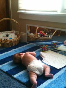 baby_laying_toys